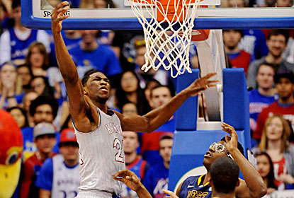 Kansas 7-foot rookie Joel Embiid contributes 11 points and 12 rebounds in the win. (USATSI)