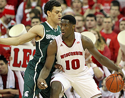 Nigel Hayes (right), who leads the Badgers with a 14 points, drives on Michigan State's Gavin Schilling. (USATSI)
