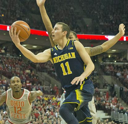 Nik Stauskas nets 15 points to help the Wolverines end a nine-game, 11-year losing streak at Columbus.  (USATSI)