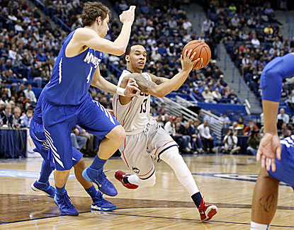 Shabazz Napier sets a career high with 34 points to lead No. 24 UConn past No. 20 Memphis. (USATSI)