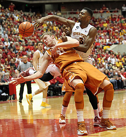 Iowa State's Melvin Ejim (right), who scores 25 points, battles Texas forward Connor Lammert for the ball. (USATSI)