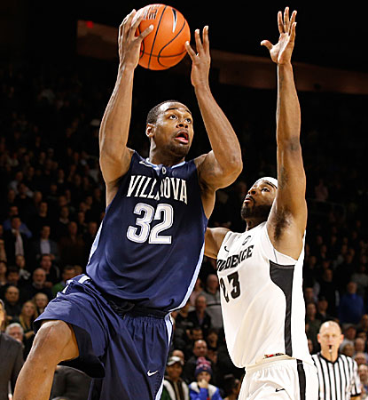 Villanova's James Bell drives against Providence's LaDontae Henton during the Wildcats' double-overtime win. (USATSI)