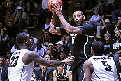Adreian Payne -- 23 points -- has a hand in the 3-point barrage for Michigan State, whose 17 3s are a school record. (USATSI)