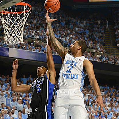 North Carolina's Leslie McDonald, who leads all players with 21 points, shoots over Duke's Quinn Cook during the second half.  (USATSI)