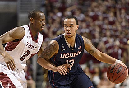 Connecticut's Shabazz Napier looks to maneuver around Temple's Will Cummings during the first half. (USATSI)