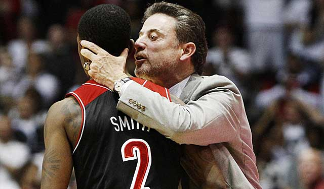 Rick Pitino gets in the ear of Russ Smith in the late-going Saturday. (USATSI)