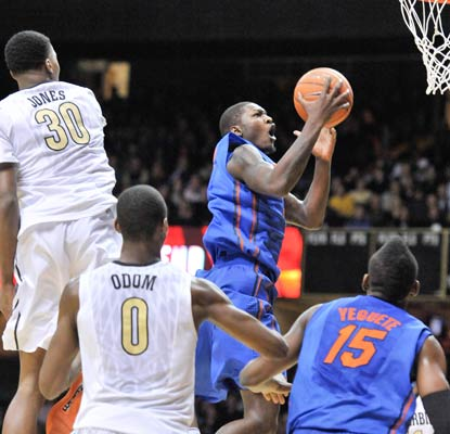 Dorian Finney-Smith cuts through the Vandy defense on his way to 19 points for the top-ranked Gators.  (USATSI)