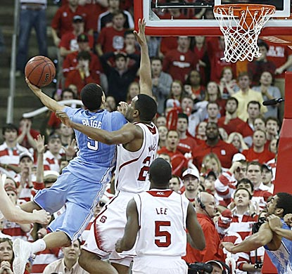 North Carolina's Marcus Paige goes around T.J. Warren and shoots over him for the winning basket in overtime.  (Getty Images)