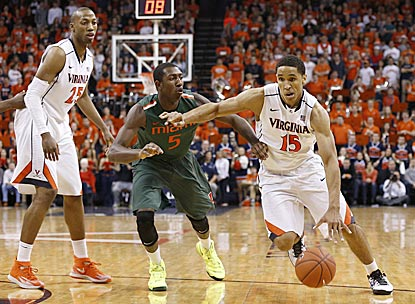 Virginia's Malcolm Brogdon drives past Miami guard Davon Reed during the second half.  (USATSI)