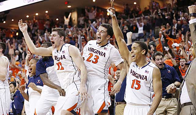 The Virginia bench celebrates near the end of Saturday's rout of Syracuse. (USATSI)