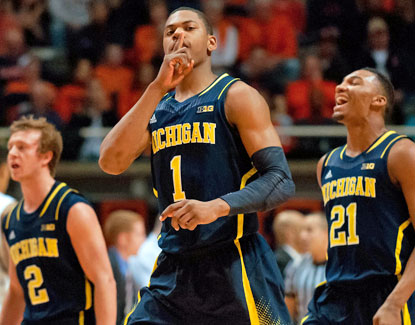Michigan's Glenn Robinson III gestures to the Illinois crowd during the Wolverines' title-clinching win. (USATSI)