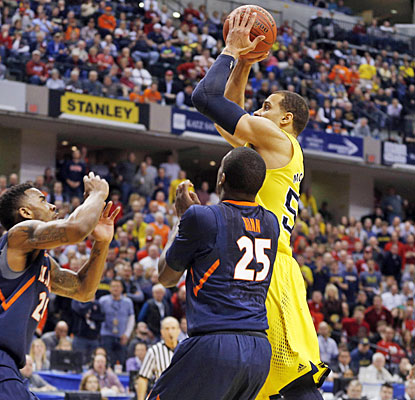 Jordan Morgan goes up for the winning basket in the final seconds, sending Michigan to the Big Ten semifinals.  (USATSI)