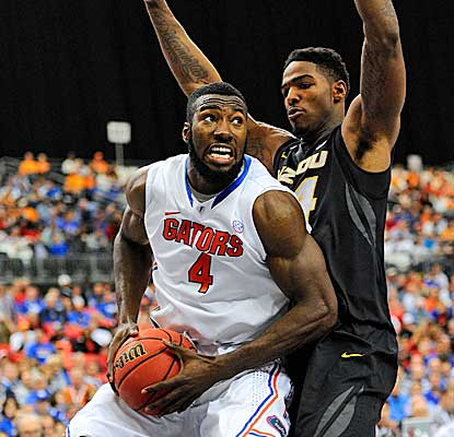 Center Patric Young contributes nine points and rips down three boards for the Gators. (USATSI)