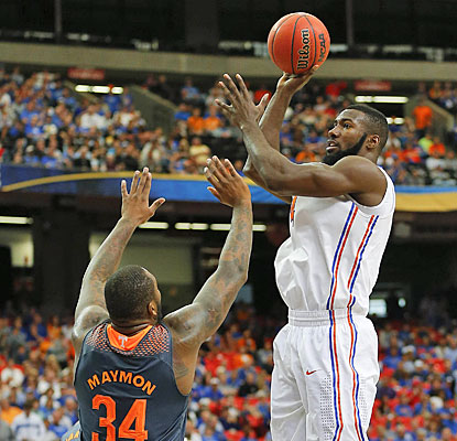 Patric Young steps up on offense (team-high 16 points) while playing his usual rugged defense for No. 1 Florida.  (USATSI)