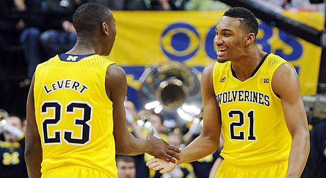 Caris LeVert and Zak Irvin celebrate during Saturday's win over Wisconsin. (USATSI)