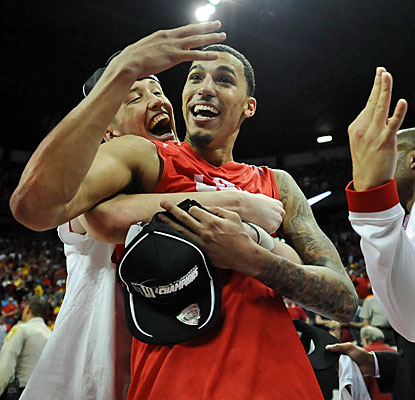 Kendall Williams and the Lobos celebrate winning an automatic berth in the NCAA Tournament after ousting No. 8 SDSU. (USATSI)