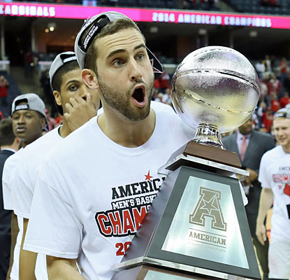 L'ville forward Luke Hancock holds the hardware the defending champs earn for winning the AAC tourney title. (USATSI)