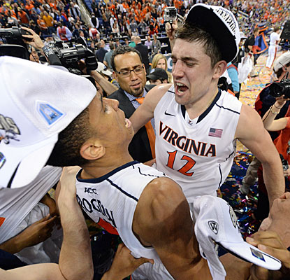 ACC tourney MVP Joe Harris (12) celebrates the Cavaliers' victory with Malcolm Brogdon, the title game's top scorer.  (USATSI)