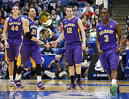 Albany's John Puk (44), Gary Johnson (20), Peter Hooley (12) and DJ Evans (right) celebrate during their First Four win. (USATSI)