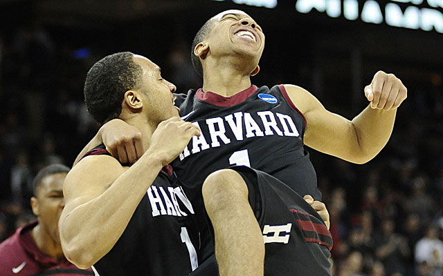 Brandyn Curry (left) celebrates Harvard's victory with Kiyani Chambers. (USATSI)