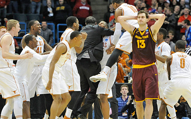 Texas celebrated while Arizona State was left deflated after Cameron Ridley's buzzer-beater. (USATSI)