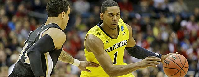 Glenn Robinson III and Michigan drive strong into the regional semis. (Getty Images)