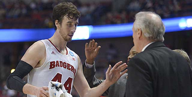Frank Kaminsky is greeted by Bo Ryan. Kaminsky scores 19 points as the Badgers advance. (USATSI)