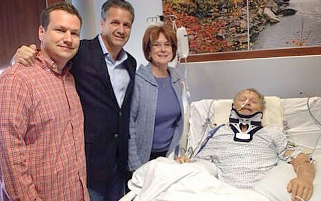 Coach John Calipari (second to left) takes the time to visit Kentucky fan Dick Gregory. (WKYT-TV)