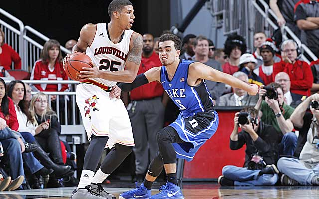 Duke's zone forces Louisville outside and the Cards shoot 16 percent from deep. (Getty Images)