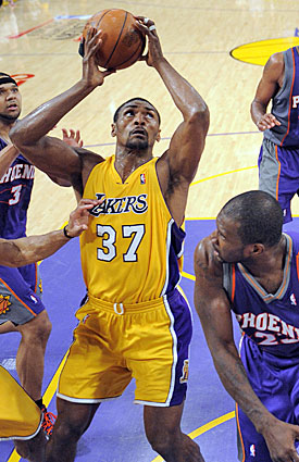 Ron Artest beats Jason Richardson to the ball before putting up the shot that lifts the Lakers to victory in Game 5. (AP)