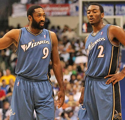 John Wall (right) scores 21 in his debut, Gilbert Arenas nets 12 in his return for the Wizards.  (US Presswire)