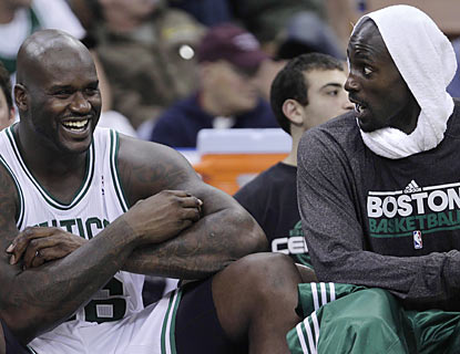 Shaq, sharing the bench and a laugh with Kevin Garnett, has no trouble fitting in as he makes his Celtics debut. (AP)