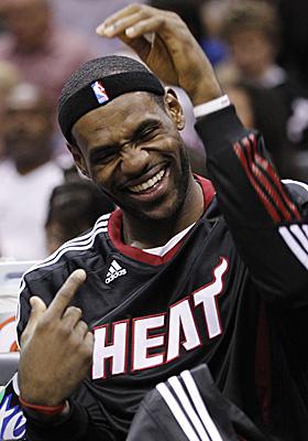 Heat newbie LeBron James jokes around with his teammates during the preseason. (AP)