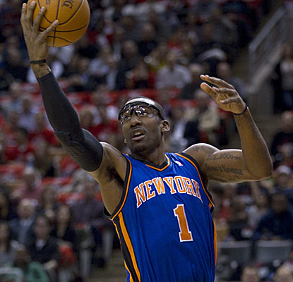 Amar'e Stoudemire drops 19 points to go with 10 rebounds to help the Knicks in their season-opener against the Raptors. (AP)