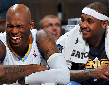 At least for one night, the Nuggets can forget all their strife as Al Harrington (left) and Carmelo Anthony share a laugh.  (Getty Images)
