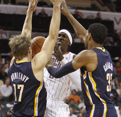 The Pacers' Danny Granger (left) gets things done on both the offensive and defensive side of the ball against the Bobcats.  (AP)