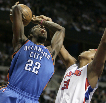 The Thunder's Jeff Green (left) is fouled by the Pistons' Charlie Villanueva while going to the basket in the first half. (AP)
