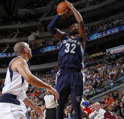 The Grizzlies' O.J. Mayo rises over the Mavericks' Jason Kidd to score two of his 20 points.   (Getty Images)