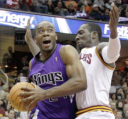 Carl Landry, shown driving on J.J. Hickson in the third quarter, winds up with 17 points.  (AP)