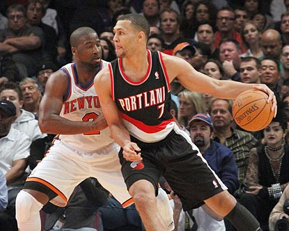 Brandon Roy (7), shown working on Raymond Felton in the first half, helps Portland earn its first 3-0 start in 11 years.  (AP)
