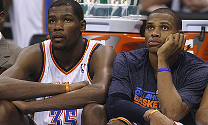 OK City's Kevin Durant (left) and Russell Westbrook watch the Jazz apply the finishing touches.  (AP)