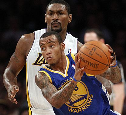Warriors guard Monta Ellis drives with Lakers forward Ron Artest in pursuit. Ellis had 20 points.  (AP)