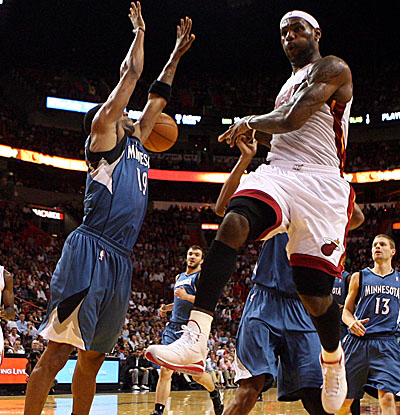 LeBron James dishes one of his game-high 12 assists in Miami's beat-down of the Wolves on Tuesday. (Getty Images)
