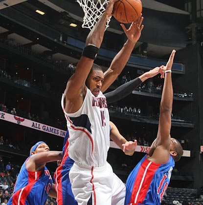 Look out below! Al Horford soars for one of his eight rebounds on the night to go with 18 points.  (Getty Images)