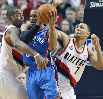 Russell Westbrook pulls in one of his 11 rebounds, to help match Kevin Durant's 28 points and 11 rebounds.  (AP)