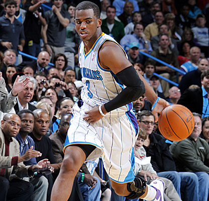 Chris Paul goes off for 13 points and 19 assists as his Hornets hold off Miami on Friday. (Getty Images)