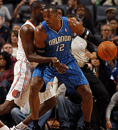 Dwight Howard puts up a 22-point, 8-board night as the Magic hold off Charlotte. (Getty Images)