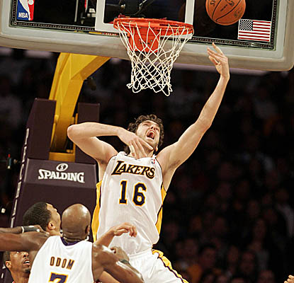 Pau Gasol puts it in the hole on his way to 20 points, 14 boards and 10 assists Sunday. (AP)