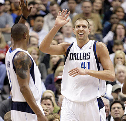 With freshly shorn locks, Dirk Nowitzki comes up with 25 points in Monday's win. (AP)