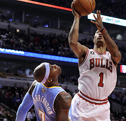 Derrick Rose lifts off for two of his team-high 18 points Monday at United Center. (AP)